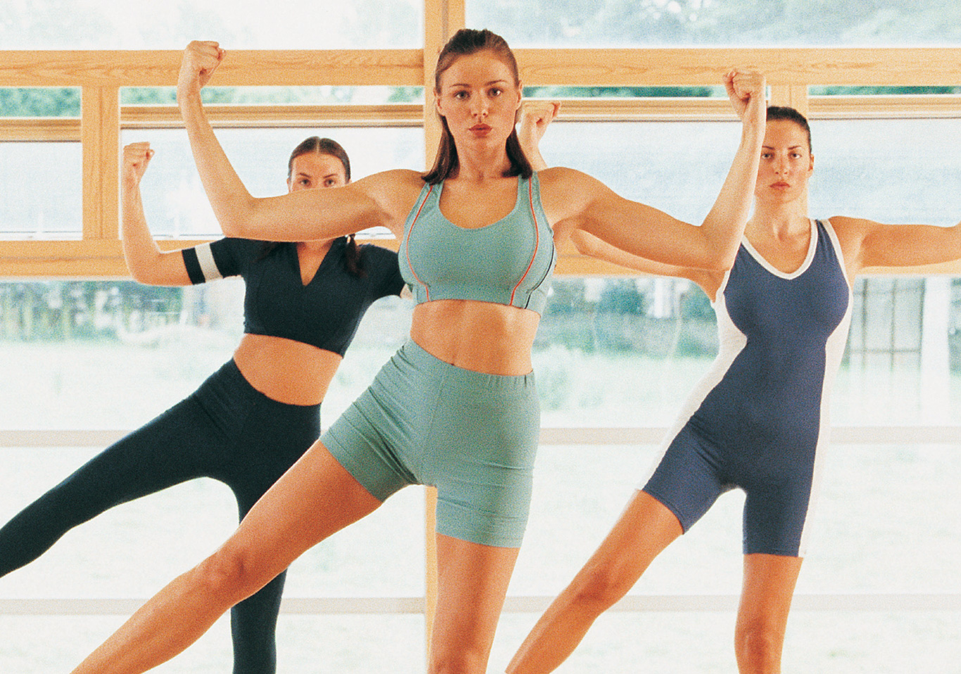 3 woman in an exercise class
